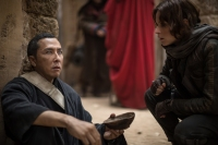 Rogue One: A Star Wars Story..L to R: Chirrut Imwe (Donnie Yen) and Jyn Erso (Felicity Jones)..Ph: Jonathan Olley..© 2016 Lucasfilm Ltd. All Rights Reserved.