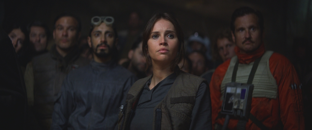 Rogue One: A Star Wars Story..Jyn Erso (Felicity Jones) in foreground, Bodhi Rook (Riz Ahmed) in background..Ph: Film Frame..Copyright 2016 Industrial Light & Magic, a division of Lucasfilm Entertainment Company Ltd., All Rights Reserved