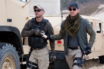 Left to right: Austin Hebert plays Prudhomme and Patrick Heusinger plays The Hunter in Jack Reacher: Never Go Back from Paramount Pictures and Skydance Productions
