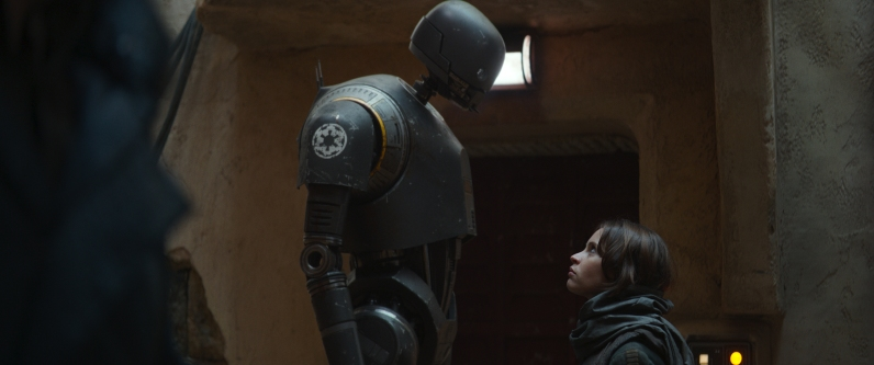 Rogue One: A Star Wars Story..L to R: K-2SO (Alan Tudyk) and Jyn Erso (Felicity Jones)..Ph: Film Frame ILM/Lucasfilm..© 2016 Lucasfilm Ltd. All Rights Reserved.